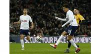 Tottenham Hotspur's English midfielder Dele Alli (2nd R) hits the bar with this shot during the English FA Cup fourth round replay football match between Tottenham Hotspur and Newport County .