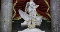The clock in the National Statuary Hall shows midnight at the U.S. Capitol February 9, 2018 in Washington, DC. //AFP
