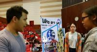 """A Thammasat University student explains his group project on """"Who are we?"""" as part of Creativity and Communication subject."""