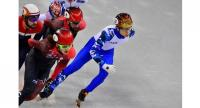 Russia's Semen Elistratov (R) competes in the men's 1,500m short track speed skating A final event during the Pyeongchang 2018 Winter Olympic Games, at the Gangneung Ice Arena in Gangneung on February 10, 2018.