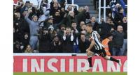 Newcastle United's Scottish midfielder Matt Ritchie celebrates after scoring the opening goal during the English Premier League football match between Newcastle United and Manchester United at St James' Park in Newcastle-upon-Tyne.