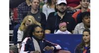 Serena Williams of Team USA, bottom left, along with her husband Alexis Ohanian and their daughter Alexis Olympia, center, watch the action during the first round of the 2018 Fed Cup at US Cellular Center.