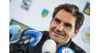 Swiss tennis player Roger Federer delivers a press conference on the first day of the ABN AMRO World Tennis Tournament in Rotterdam .