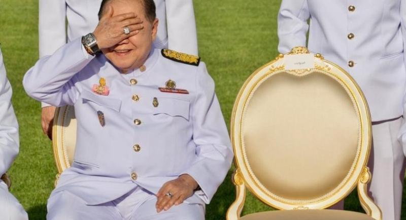 n this photograph taken on December 4, 2017, Thailand's junta number two Prawit Wongsuwan covers his eyes, displaying a watch he is wearing, during a photo call with other members of a new cabinet in Bangkok./AFP