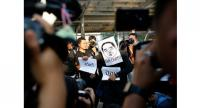 File Photo: A Thai political activist (C) wears a mask depicting Thai Deputy Prime Minister and Defense Minister General Prawit Wongsuwan with the message 'Get Out!' as he holds a symbolic protest near the Chong Non Si BTS station in Bangkok./EPA-EFE