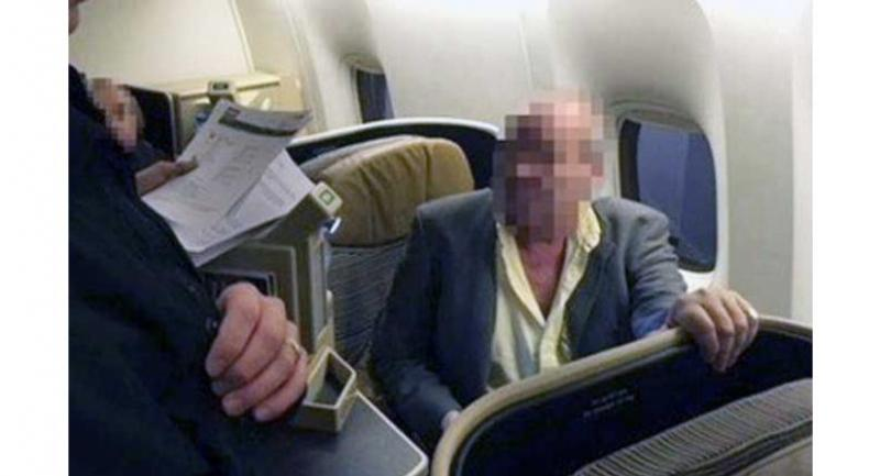 The moment a British money-laundering suspect is arrested on a flight from Thailand.