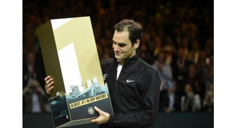 Switzerland's Roger Federer poses with the trophy as he celebrates after victory over Netherlands Robin Haase in their quarter-final singles tennis match for the ABN AMRO World Tennis Tournament in Rotterdam on February 16, 2018.