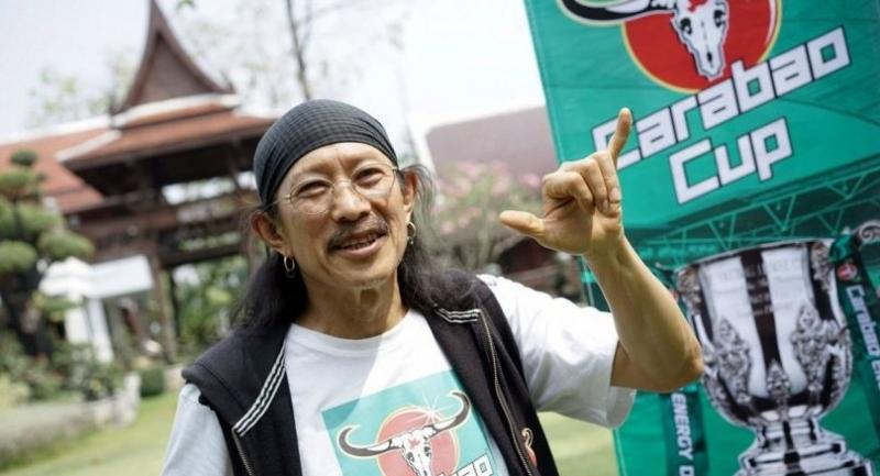 This photograph taken on February 17, 2018 shows Yuenyong Opakul, 63, lead singer of legendary Thai rock band Carabao and owner of Carabao energy drink, posing for a portrait outside his home in Bangkok.  AFP PHOTO