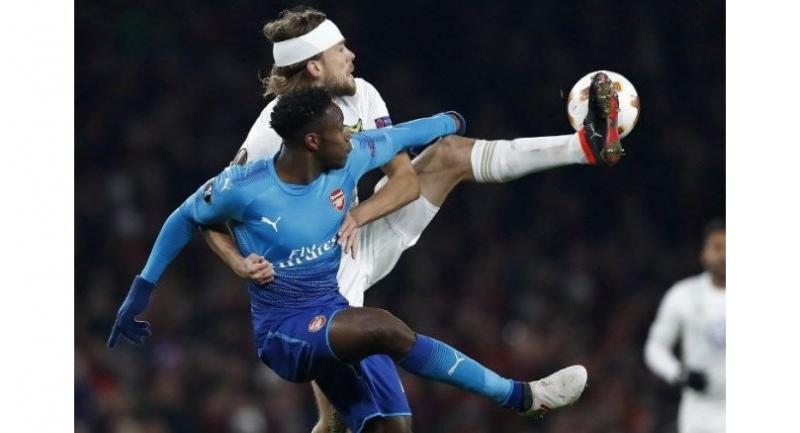 Ostersunds' Swedish defender Tom Pettersson vies with Arsenal's English striker Danny Welbeck during the second leg of the Europa League Round of 32 football match between Arsenal and Ostersunds at the Emirates Stadium in London on February 22, 2018.