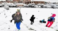 The area around Rome's famous ancient Roman chariot racing stadium (Circo Massimo) is transformed into a winter wonderland for children and youths with sleds, skis and snowboards following unusually heavy snowfall, Rome, 26 February 2018. EPA-EFE