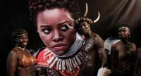 Dancers from Kenya's Luo tribe pose in front of an image of Kenyan actress Lupita Nyong'o before the African premier of the Marvel film