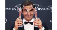 Swiss tennis player Roger Federer poses with his sportsman and comeback award trophies during the 2018 Laureus World Sports Awards ceremony at the Sporting Monte-Carlo complex in Monaco on February 27, 2018.