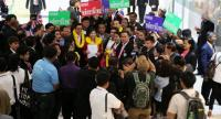 Supporters of various prospective political parties gather at the Election Commission's head office  on the first day of pre-registration yesterday.