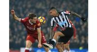Liverpool's English midfielder James Milner (L) vies with Newcastle United's Brazilian midfielder Kenedy during the English Premier League football match between Liverpool and Newcastle at Anfield in Liverpool, north west England on March 3, 2018.