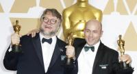 "Guillermo del Toro, left, whose film ""The Shape of Water"" won him Best Director and Best Picture, with his producer J Miles Dale. /EPA-EFE photo"
