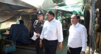 File photo: Thanasit Metphanmuang (R) director of the Prawet District Office
