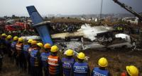 Rescue teams next to a wreckage of a plane that crashed at the main airport Tribhuvan International Airport in Kathmandu, Nepal, 12 March 2018.// EPA-EFE PHOTO