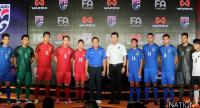 Thai FA president Somyot Poompanmoung, middle, Warrix Sport Company managing director Wisan Wanasaksrisakul, 6th from right, and national players wearing the new jerseys.