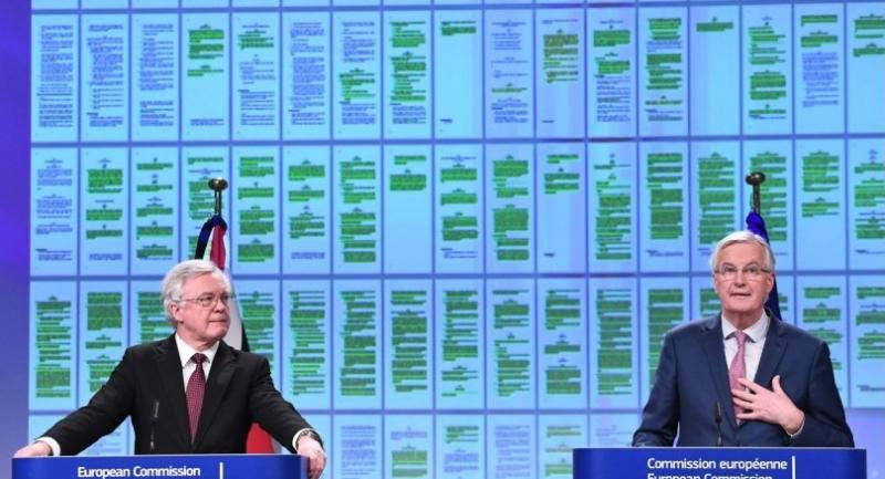 British Brexit minister David Davis (L) and EU chief negotiator Michel Barnier address a press conference after their meeting at the European Commission in Brussels on March 19.//AFP