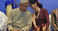 This file photo taken on October 15, 2017 shows Myanmar's President Htin Kyaw (L) and Myanmar's State Counsellor Aung San Suu Kyi talking during the second anniversary of the Nationwide Ceasefire Agreement (NCA) ceremony in Naypyidaw./AFP