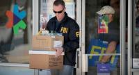 FBI agents collect evidence at a FedEx Office facility following an explosion at a nearby sorting center on March 20, 2018 in Sunset Valley, Texas. //AFP