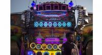 This photograph taken on December 23, 2017 shows a driver standing in front of his truck, decorated with mirrors and loudspeakers, at a fancy truck party in the Thai coastal province of Rayong. // AFP PHOTO