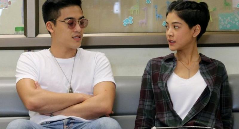"File photo: Apinya Sakuljaroensuk or ""Saipan"" (R) and her boyfriend."