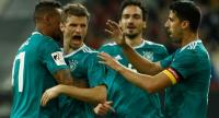 Germany's forward Thomas Mueller (2nd L) is congratulated by his teammates  Jerome Boateng (L), Germany's defender Mats Hummels (2nd R) and Germany's midfielder Sami Khedira (R) after scoring the 1-1 during the international friendly.