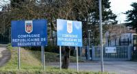 The gates to the police precinct where a police officer out jogging was heading to before he was shot and injured by a man who had hijacked a car and killed the owner in Carcassonne, southwestern France on March 23, 2018./AFP