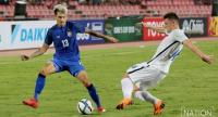 Philip Roller of Thailand (right) vies for the ball with Robert Mazan.