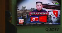 A man watches a television news about a suspected visit to China by North Korean leader Kim Jong Un, at a railway station in Seoul on March 27.//AFP
