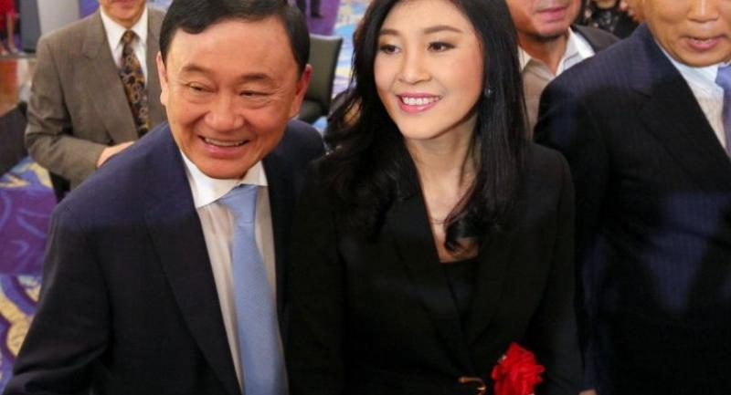 Thaksin and Yingluck on a private visit in Tokyo. Photo: AFP