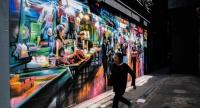 From murals made famous by Instagram to painting battles, Hong Kong's once largely underground street art scene has exploded in recent years, and is now blossoming across the city's walls and alleyways. /AFP