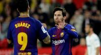 Barcelona's Argentinian forward Lionel Messi (R) celebrates a goal with Barcelona's Uruguayan forward Luis Suarez during the Spanish League football match between Sevilla FC and FC Barcelona at the Ramon Sanchez Pizjuan stadium on March 31, 2018.