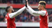 Arsenal's Gabonese striker Pierre-Emerick Aubameyang (R) celebrates scoring the team's second goal with Arsenal's French striker Alexandre Lacazette during the English Premier League football match between Arsenal and Stoke City.