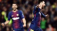 Barcelona's Argentinian  Lionel Messi celebrates after AS Roma scored an own goal during the UEFA Champions League quarter-final first leg football match between Barcelona and AS Roma at the Camp Nou Stadium in Barcelona on April 4, 2018. / AFP