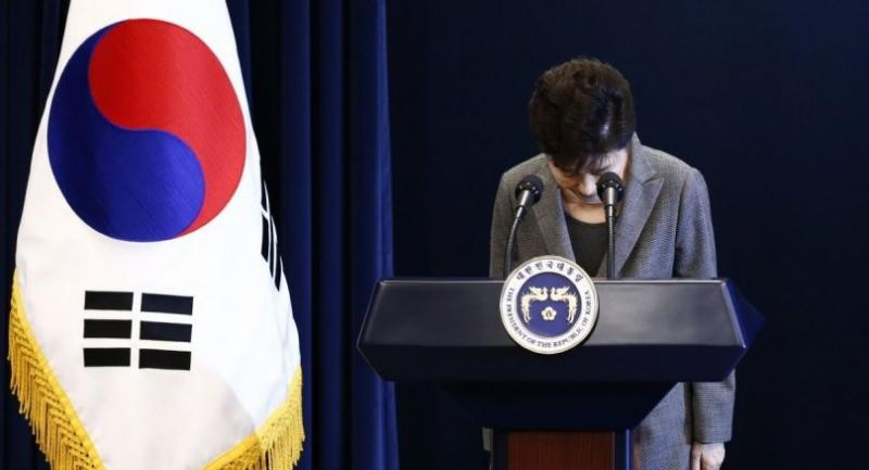 This file photo taken on November 29, 2016 shows South Korea's President Park Geun-Hye bowing during an address to the nation, at the presidential Blue House in Seoul./AFP