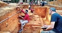 A team of archaeologists work to unearth a site believed to be the royal palace of King Jayavarman II, who made his capital atop Phnom Kulen. Photo supplied