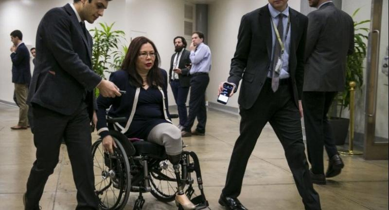 U.S. Sen. Tammy Duckworth (D-IL) speaks with reporters as she arrives for the weekly Senate Democrat's policy luncheon, on Capitol Hill, December 12, 2017 in Washington, DC. Al Drago/Getty Images/AFP