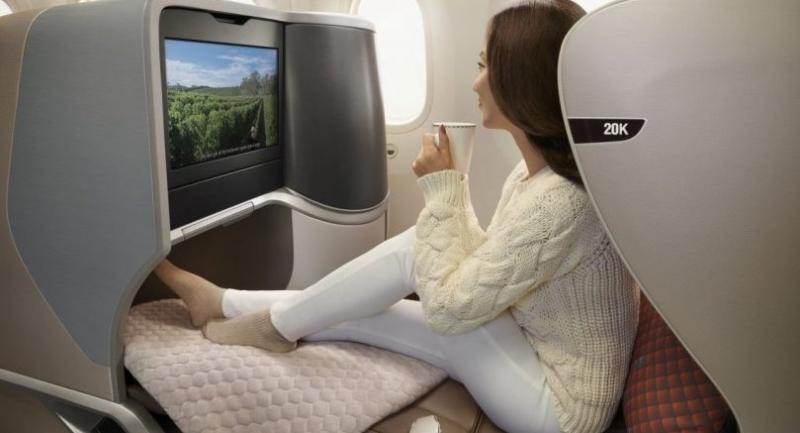 All business-class seats offer direct aisle access and convert into 76-inch fully flat beds.