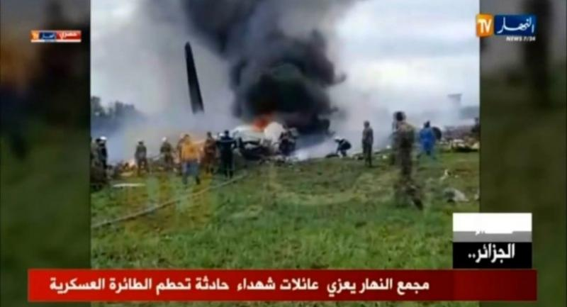 A grab from a video brodcast by Algeria's Ennahar satellite television channel on April 11 shows the scene of the crash of a transport plane, carrying around 100 Algerian army personnel on board.//AFP