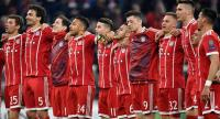 Bayern Munich's players celebrate with their fans after the UEFA Champions League quarter-final second leg football match between FC Bayern Munich and Sevilla FC on April 11, 2018 in Munich, southern Germany. / AFP PHOTO / John MACDOUGALL