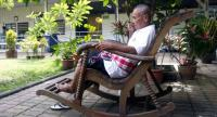 File photo: An old man sits silently at a state-run home for the elderly. Many elderly Thais have neither children nor grandchildren by their sides in their final years.