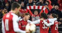 Arsenal's players celebrate a goal during the UEFA Europa League second leg quarter-final football match between CSKA Moscow and Arsenal at VEB Arena stadium in Moscow on April 12, 2018. / AFP PHOTO / Alexander NEMENOV