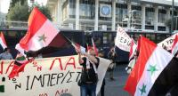 Anti-war movement members protested during a rally against the possibility of an attack on Syria outside the US Embassy, in Athens, Greece, on April 13.//EPA-EFE