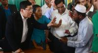 Myanmar Social Welfare Minister Win Myat Aye (L) talks to Rohingya refugees during his visit to the Kutupalong refugee camp in Bangladesh's Ukhia district on April 11, 2018. AFP