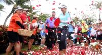 Brooke Henderson of Canada laughs as flower petals fall, at a victory ceremony, after her four shot win in the LPGA LOTTE Championship at the Ko Olina Golf Club on April 14, 2018 in Kapolei, Hawaii. Harry How/Getty Images/AFP