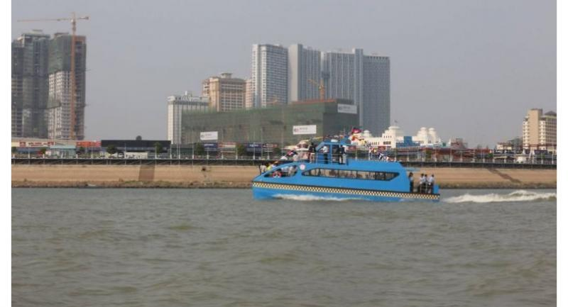 One of Phnom Penh's new water taxis makes its inaugural trip last week. Ministry of Public Works and Transport/Facebook