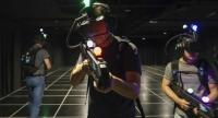 A group of gamers wearing virtual reality headsets at Zero Latency Singapore, in Singapore. / AFP