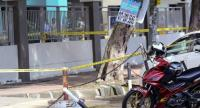 Malaysian forensic police cordon off the area where a Palestinian scientist was assassinated in Kuala Lumpur on April 21.//AFP